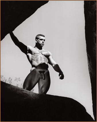 Jim French original gelatin silver print depicting a male nude standing on a rock formation